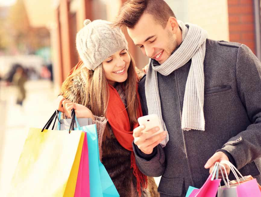 eCommerce Advent Calendar social share couple looking at phone with bags xmas theme